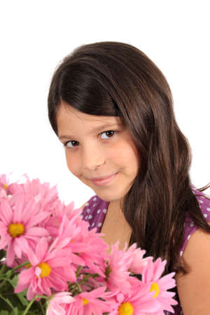 Pretty eight year old adolescent multi ethnic girl with long dark hair and pink daisy flowers on   a white background Stock Photo - 8244594