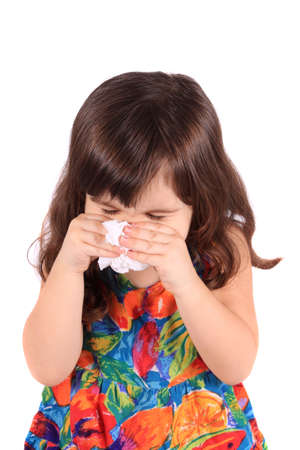 Little three year old girl having the sniffles or sneezing from being sick or allergies