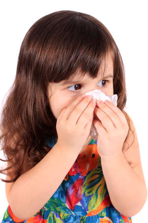sniffles: Little three year old girl having the sniffles and wiping her nose with tissue from being sick or allergies