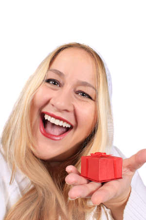 Happy smiling blonde woman showing a small red present box in her hand photo