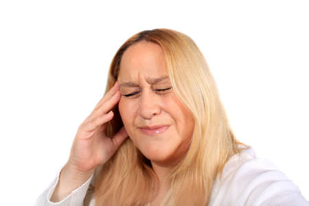 Woman holds head with tension pain showing on her face due to a headache or a migraine photo