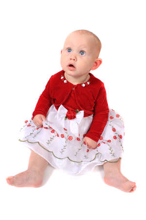 velvet dress: Six month old baby girl with big blue eyes and red velvet jacket looking up on a white background (not isolated)