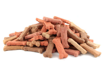 treats: Pile of dog biscuits in the shape of a bone on a white background (not isolated) Stock Photo