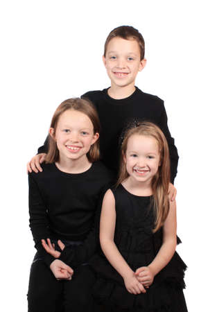 Hermanos de diferentes edades, dos hermanas y un hermano sobre un fondo blanco Foto de archivo - 8803863
