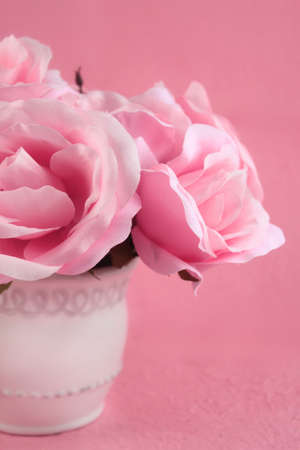Centerpiece of quaint pink roses on a pretty feminine background