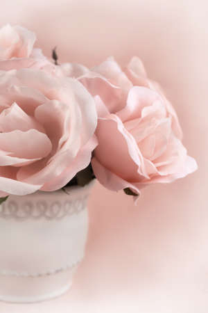 Centerpiece of sepia  roses on a pretty feminine background with copy space Archivio Fotografico