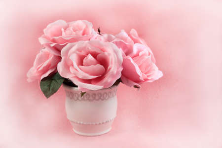Centerpiece of quaint pink roses on a pretty feminine textured  background with copyspace Stock Photo - 8803893