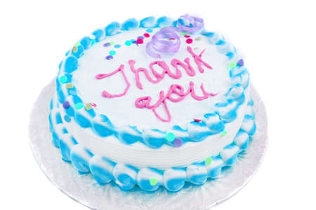 blue and white frosted festive cake with thank you written in blue on a white background photo
