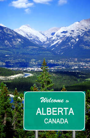 Welcome to Alberta Canada highway sign in front of the Rocky Mountains in Canmore