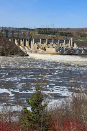 Dam producing energy through water in Mactaquac, outside of Fredericton NB,  Canada photo