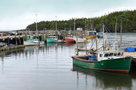 Colorful fishing boats docked in Chance Harbor, New Brunswick, Canada  Stok Fotoğraf