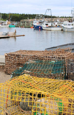 crustaceans: Maritime traps for lobsters and other crustaceans with colorful buoys on  fishermens wharf with fishing boats in the Bay of Fundy, New Brunswick, Canada