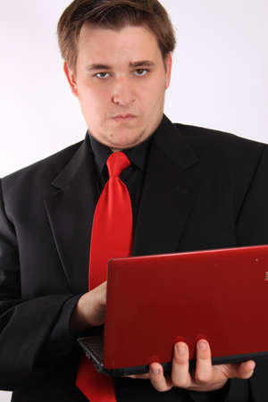 netbook: Handsome young businessman holding small netbook computer on white background