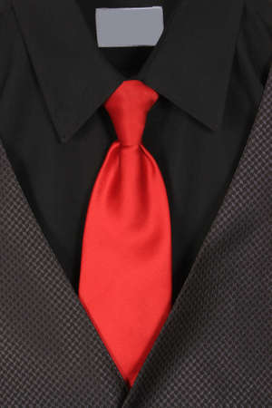 Black dressy business shirt, vest  and red tie photo