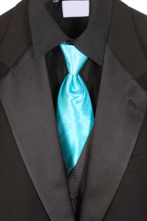 Black dressy formal suit with shirt, vest  and blue tie Stock Photo