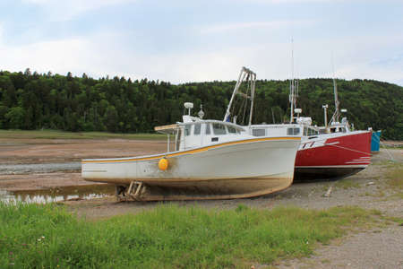 Beached, fishing boats in Alma, on the Bay of Fundy, New Brunswick Stock Photo - 10004283