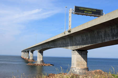 confederation: Confederation bridge connecting New Brunswick to Prince Edward Island with sign