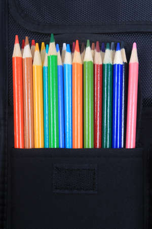 Colorful sharpened  pencil crayons for school in three ring binder pocket Reklamní fotografie