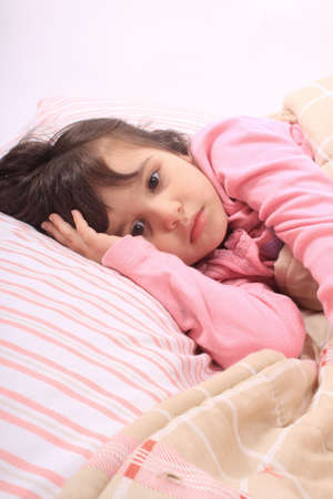 Cute little girl laying in bed and cant fall asleep photo