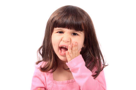 four year old: Cute young four year old child holding her cheek with a toothache