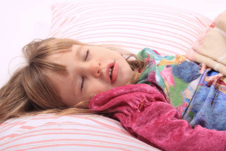 sleep: Cute little girl laying in bed sleeping cozy on her pillow and in her blanket  Stock Photo