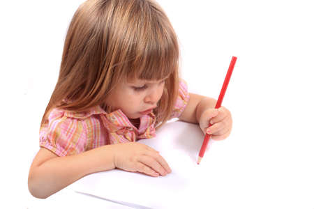 2 year old: Cute little two year old girl draws pictures on white paper