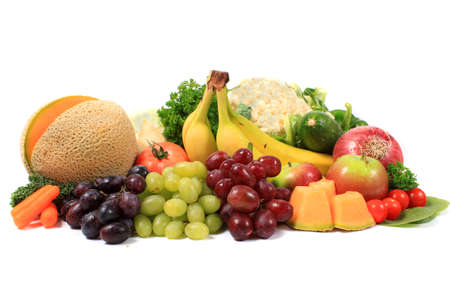 Group of colorful fruits and vegetables like grapes, bananas, and cauliflower on a white background Stock Photo