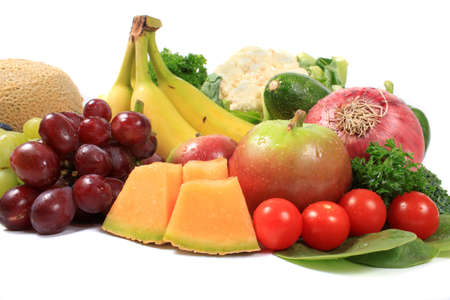 Group of colorful fruits and vegetables like grapes, bananas, and cauliflower on a white background 写真素材