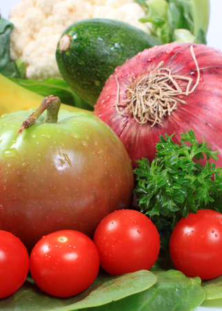 Group of wet with dew drops fruits and vegetables like grapes tomatoes, apple, red onion Stock Photo - 10713584