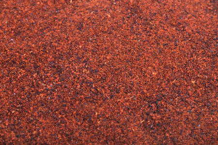 Close up of vibrant rusty color chili powder spice
