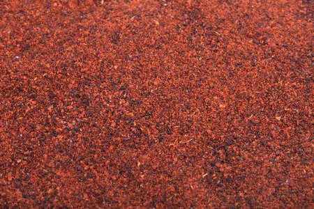 Close-up van levendige roestige kleur chilipoeder spice