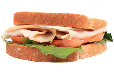 Turkey and cheese sandwich on whole wheat bread with tomato and lettuce ready for lunch photo