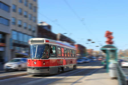 Streetcar transportation in downtown Toronto, Canada with motion blur photo