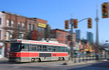 streetcar: Streetcar transportation in downtown Toronto, Canada with motion blur Stock Photo