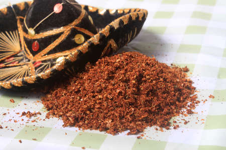 blend: Close up of spices in a Mexican blend for authentic cuisine with small sombrero Stock Photo