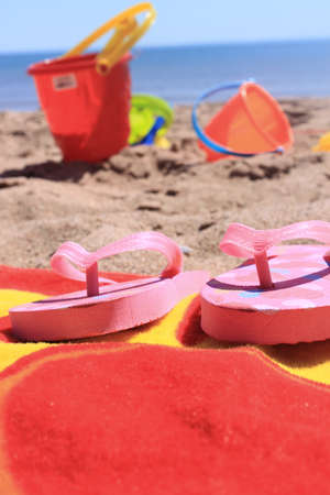 beach toys: Colorful beach toys and towel in the sandy shores of Panmure Island in Prince Edward Island, Canada