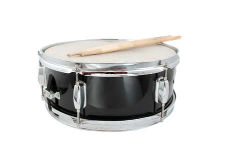 Snare drum and drumsticks on a white background (short depth of field) Archivio Fotografico