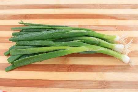 Green onions or scallions  on wooden cutting board Stock Photo - 14874356