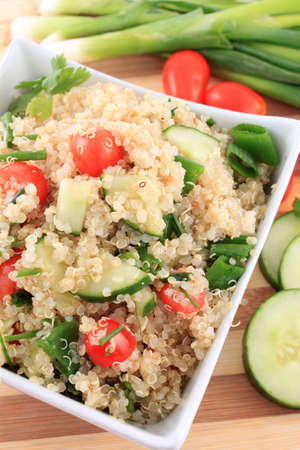 quinoa: Cold quinoa salad with cucumbers, cherry tomatoes, green onions and herbs