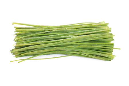 Fresh chives with water droplets on a white background Stock Photo