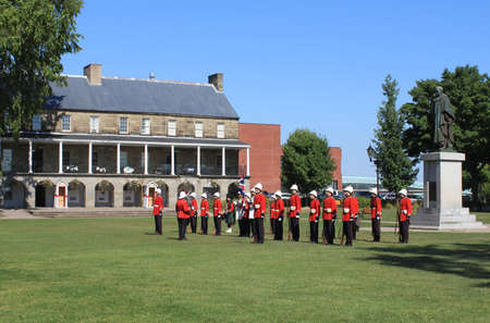 reenact: FREDERICTON, NB, CANADA - CIRCA AUGUST 2012 - The Changing of the Guard Ceremony at Officers Square  where period guards re-enact a drill ceremony circa August 2012