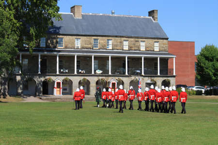 reenact:  The Changing of the Guard Ceremony at Officers Square  where period guards re-enact a drill ceremony