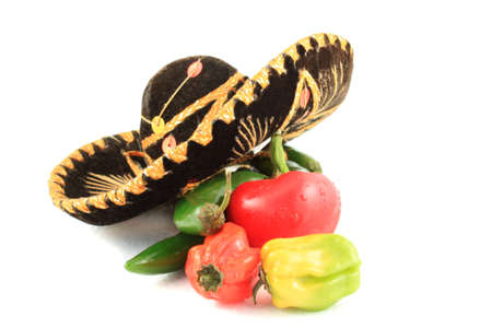 habanero: Variety of hot peppers including jalapenos with sombrero on white background