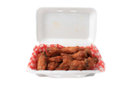 Take out thai chilli chicken wings in package on a white background