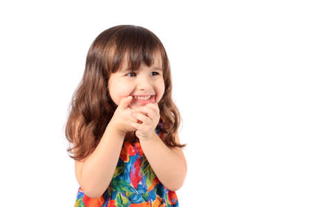 shyness: Cute little year old girl smiling like a shy girl on a white background