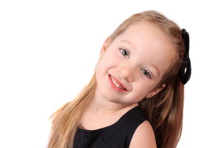 long: Cute little smiling girl with sparkly sequin bow in her hair on a white background