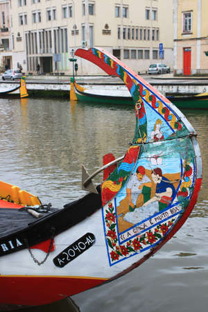 prow: AVEIRO, PORTUGAL- APRIL,03,13: Colorfully painted prow of decorated seaweed collecting boat docked in Central Canal, Aveiro, Portugal on April 3, 2013