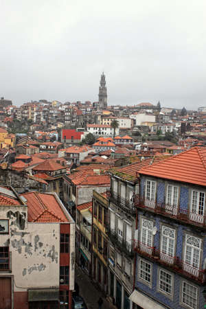 Rooftops and numerous churches in the city of Porto, Portugal, Europe on a rainy day