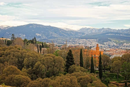 granada: View of Granada, Spain, with mountains Sierra Nevada in the background
