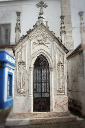 crypt: Creepy family tomb made of decorative marble in a cemetary in Portugal